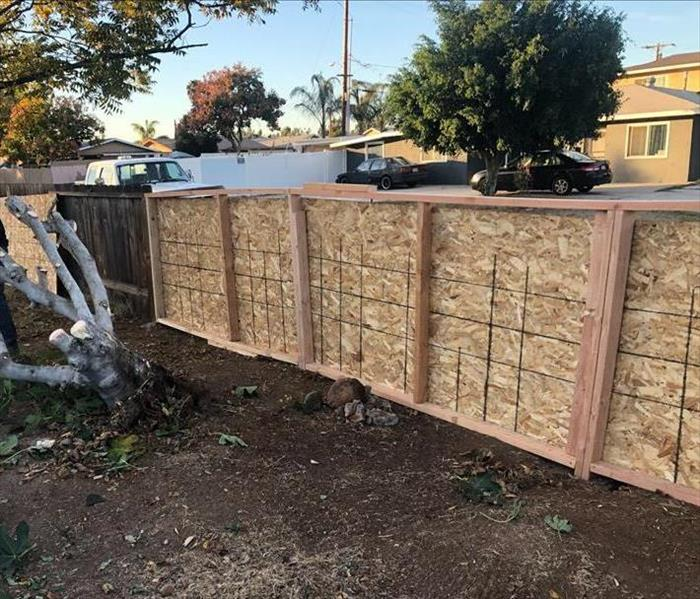 Plywood temporary fence and cleaned up yard