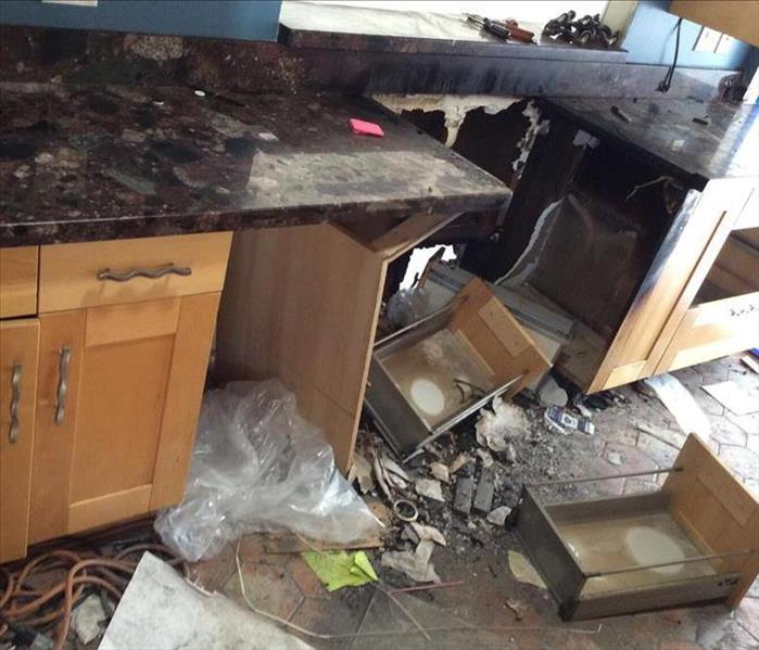 kitchen cabinets with fire damage and soot