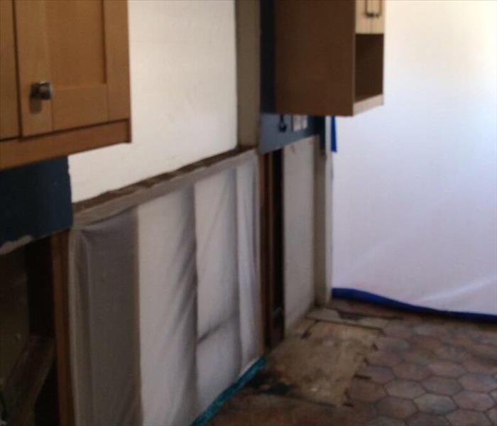 kitchen clean with fire damaged cabinets removed